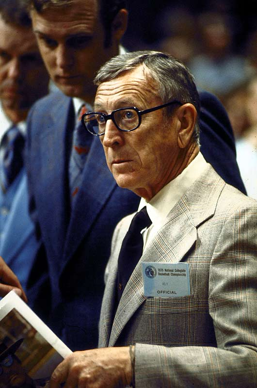Coaching legend John Wooden watches his UCLA squad take on Lousiville during the Final Four. The Bruins defeated the Cardinals to advance to the championship game, where they went on to beat Kentucky.