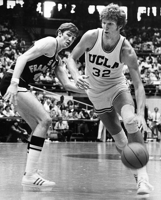UCLA center Bill Walton blows by San Francisco's Eric Fernston during a 1974 tournament game.
