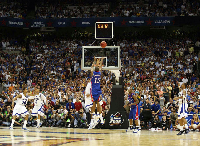 Kansas point guard Mario Chalmers nails a game-tying three pointer over Memphis' Derrick Rose to force the 2008 Championship game into overtime. Kansas would go on to beat Memphis, which held a nine-point lead with just over two minutes left in regulation, in the extra period.