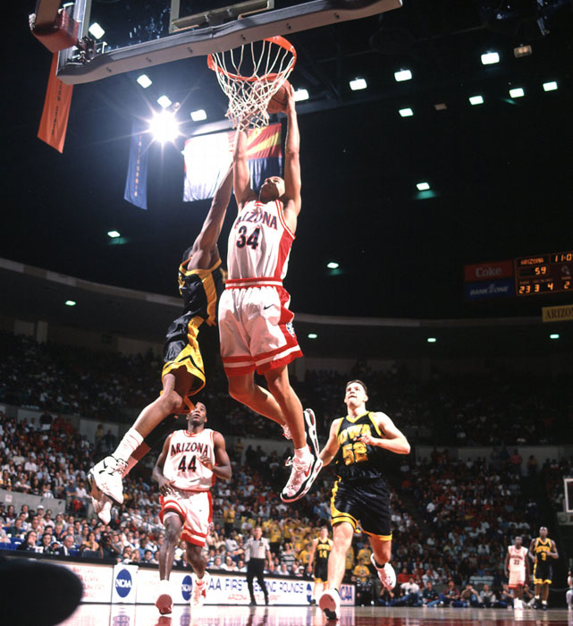 Arizona guard Miles Simon dunks on an Iowa player during the 1996 tournament.