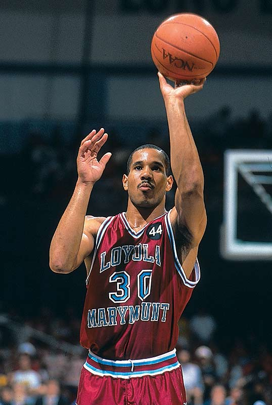 Loyola Maramount's Bo Kimble pays tribute to his late teammate Hank Gathers during a second-round victory over Michigan.