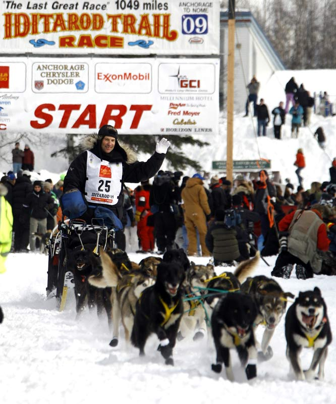 Musher Hans Gatt drives his team down the start chute to begin the race in Willow, Alaska.