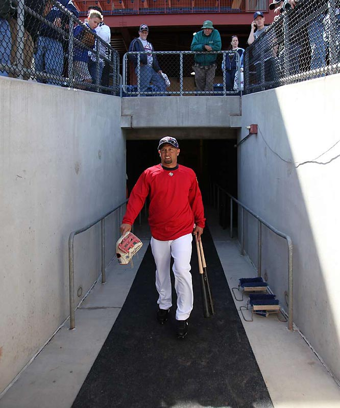 "Phillies outfielder Shane Victorino walks out of the tunnel for the squad's first workout. The ""Flyin' Hawaiian"" will add speed to the top half of the lineup."