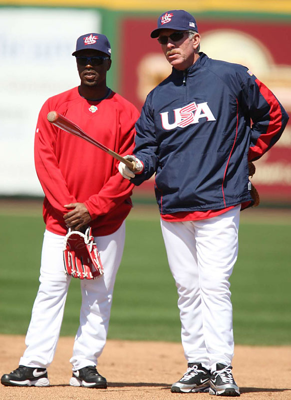 Philadelphia shortstop Jimmy Rollins talks things over with Phillies great Mike Schmidt near second base.