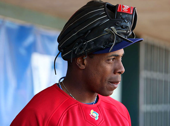 Detroit outfielder Curtis Granderson looks on from the dugout during Monday's workout. The American squad failed to qualify for the medal round at the last WBC, losing to Mexico and South Korea in Group play.