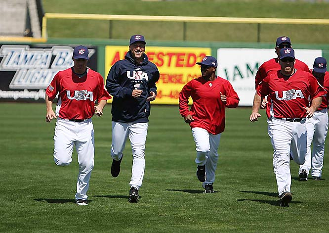 Derek Jeter (center in blue) participates in running drills during Team USA's first day of workouts at Clearwater, Fla.