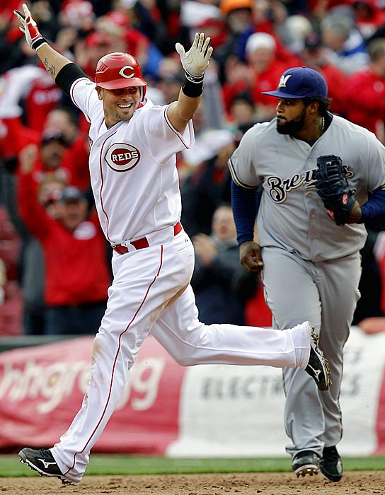 Ramon Hernandez hit a two-out, three-run homer off closer John Axford in the bottom of the ninth inning, rallying the Cincinnati Reds to a 7-6 victory over the Milwaukee Brewers in an opening-day flashback to their NL Central title season.