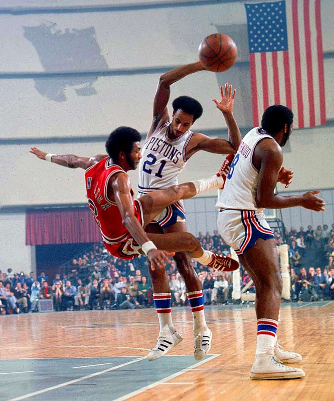 Bing (No. 21) watches Chicago's Norm Van Lier takes a tumble.