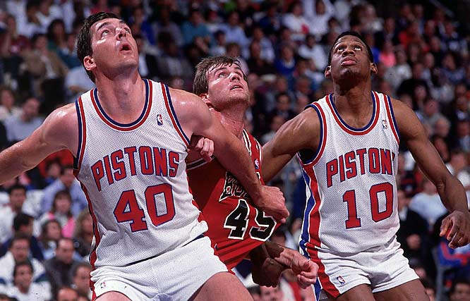 Laimbeer and Rodman battle Ed Nealy during the NBA Eastern Conference Playoffs.