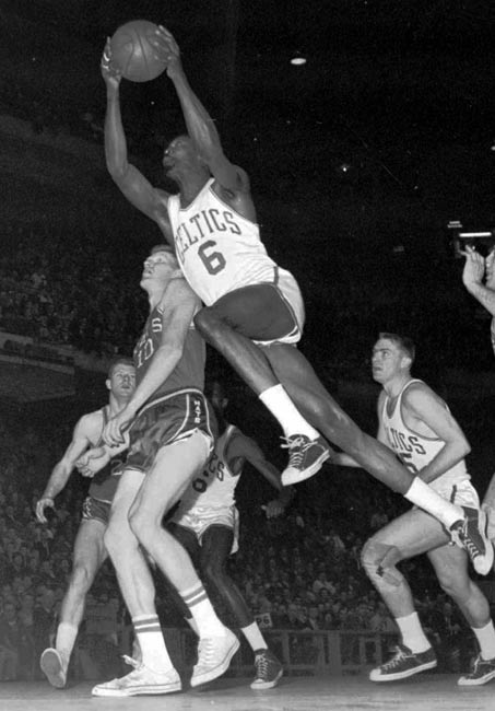Boston's Bill Russell grabs 49 rebounds, the third-highest total in NBA history, in a 112-100 win over Detroit.
