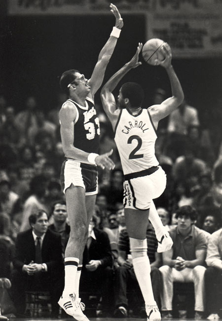 Golden State's Joe Barry Carroll (pictured here against Kareem Abdul Jabbar) scores 52 points in a 127-121 Warriors victory over the Utah Jazz.