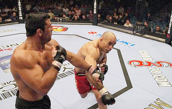A wrestler at Iowa State, Van Arsdale (red trunks) won the 1998 NCAA Division I Championship at 167 pounds. He was later inducted into the Iowa Wrestling Hall of Fame. As a professional mixed martial artist, Van Arsdale has an 8-5 record, including this win over John Marsh at UFC 52.<br><br>Send comments to siwriters@simail.com