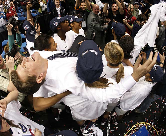 Geno Auriemma was carried off the court by his team, just as he was in 1995 by his first team.