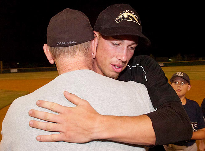 Shown here with his father after the game, Schuster is now 7-0 on the season.