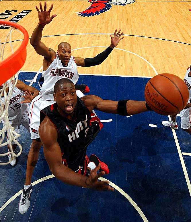 The regular-season scoring leader reeled off 13 consecutive Miami points to close the first half and banked in a late three-pointer to thwart an Atlanta rally in a 108-93 victory. Wade made six threes as part of his 33 points.