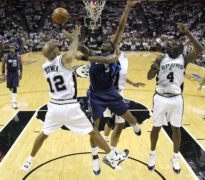 Josh Howard scored 25 points and Dirk Nowitzki  added 19 to key the Game 1 upset. The Mavs hadn't won a road playoff game since going to the Finals in 2006.