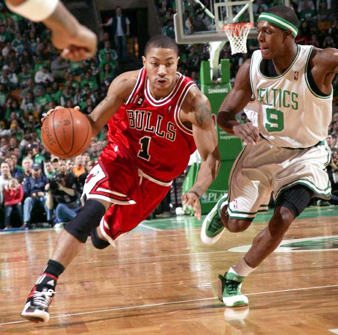 Derrick Rose tied Kareem Abdul-Jabbar's record with 36 points in his playoff debut -- and added 11 assists -- to lead the Bulls to a 105-103 overtime victory over the defending NBA champion Celtics in Game 1.