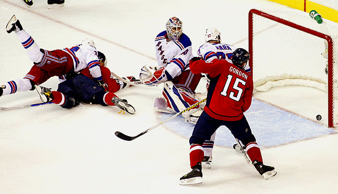 Alex Ovechkin is knocked down by Rangers left wing Aaron Voros as he scores on Henrik Lundqvist during the second period of Game 5 of the Eastern Conference quarterfinals.