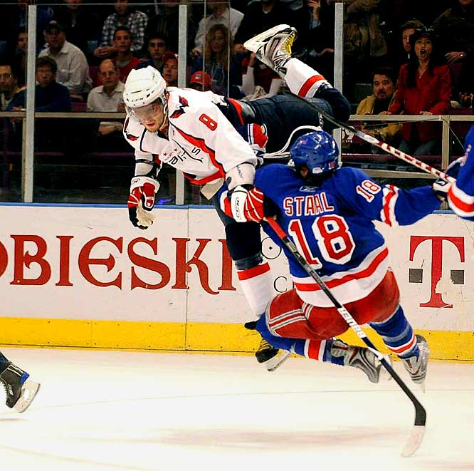 Alex Ovechkin throws a flying check at Rangers defenseman Marc Staal in Game 3 of the Eastern Conference quarterfinals.