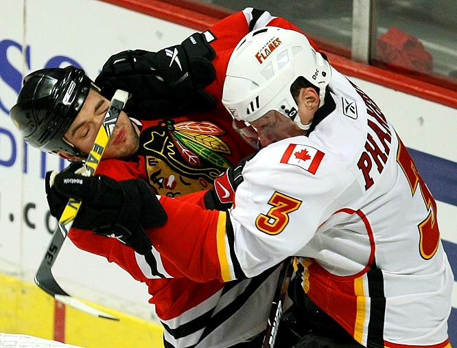 Flames defenseman Dion Phaneuf checks the Blackhawks' Brent Seabrook in the first period during Game 2 of the Western Conference quarterfinals.