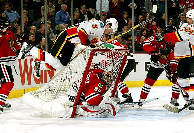 Dion Phaneuf jumps onto the back of the net as it comes down on Blackhawks goalie Nikolai Khabibulin during Game 1 of the Western Conference quarterfinals.