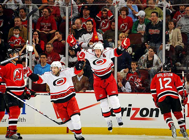 Hurricanes forwards Erik Cole (left) and Eric Staal celebrate Tim Gleason's game-winner against the Devils 2:40 into overtime of Game 2 of their Eastern Conference quarterfinal.