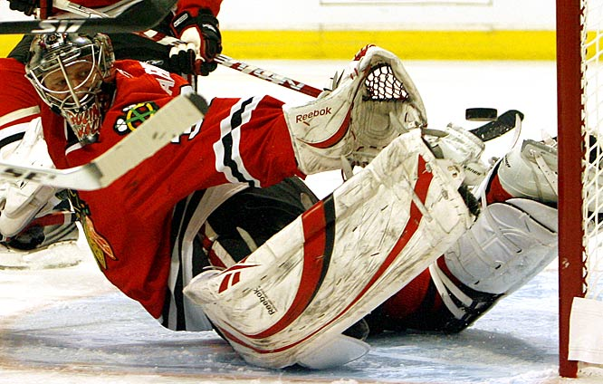 Blackhawks goalie Nikolai Khabibulin blocks a shot by the Flames' Todd Bertuzzi during the first period of Game 2 of the Western Conference quarterfinals.
