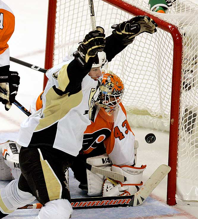 Penguins center Sidney Crosby celebrates his game-tying goal against the Flyers' Martin Biron late in the second period of Game 6 of their Eastern Conference quarterfinal.