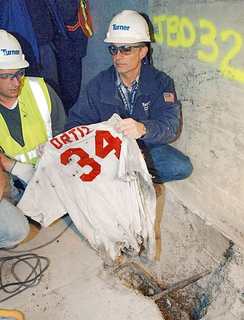 Construction workers at the new Yankee Stadium the site dig up a Red Sox jersey buried in concrete from the ballpark scheduled to be completed in 2009.The tattered David Ortiz jersey, which will be auction off to raise money for the Jimmy Fund, was buried by a Bronx construction worker, a Boston fan, who had hope to put a hex on the Bombers.