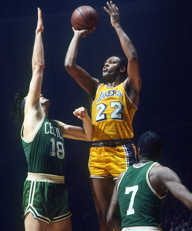 Los Angeles Lakers forward Elgin Baylor scores 61 points in Game 5 against the Boston Celtics to set an NBA Finals record.