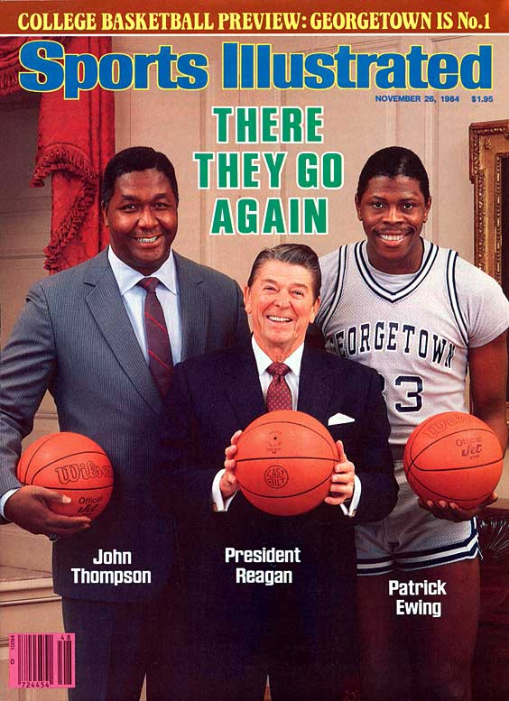 John Thompson (pictured here with Ronald Reagan and Patrick Ewing) becomes the first African-American coach to lead his team to the NCAA college basketball championship.