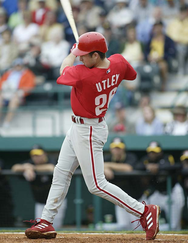 Chase Utley scored his first major-league hit by blasting a third-inning grand slam off Rockies starter Dennis Cook.