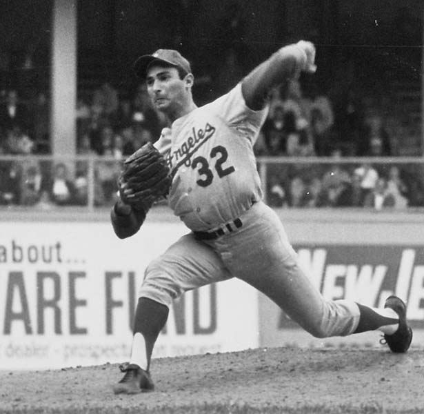 Los Angeles Dodgers pitcher Sandy Koufax struck out 18 batters to become the first major-league pitcher to do so in two different games.