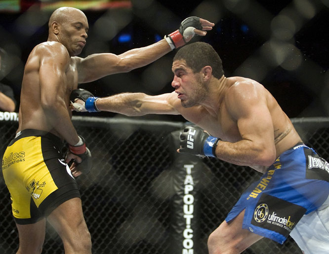 "Middleweight champ Silva (yellow trunks) made history with his unanimous-decision win over Leites. The ""Spider"" set a UFC record with nine straight victories in the Octagon."
