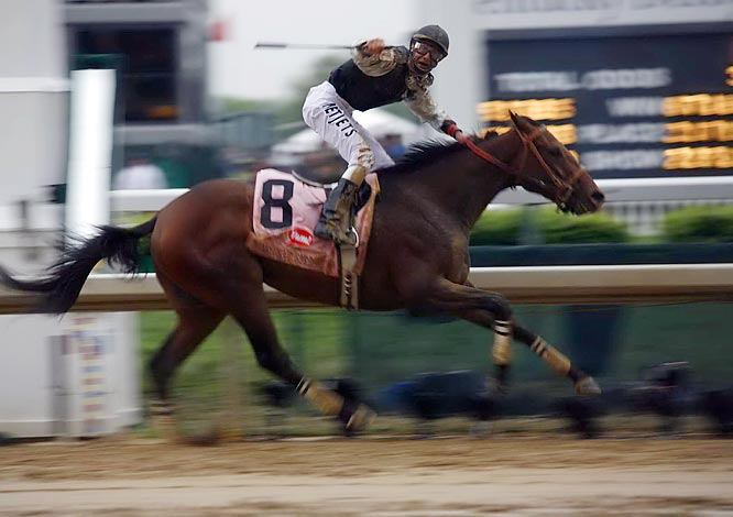 Jockey Calvin Borel stuck to a pre-race strategy of hugging the rail -- traditionally the dryest, smoothest spot on a muddied track.