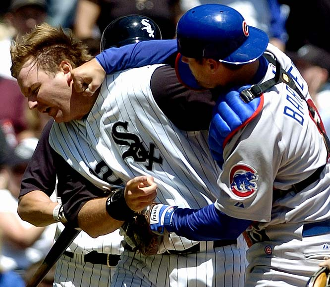 White Sox catcher A.J. Pierzynski, one of the game's most notorious rabble-rousers, ran over Cubs catcher Michael Barrett to score on a sacrifice fly. Pierzynski emphatically slapped home plate and went to pick up his helmet when Barrett collided with him and slugged him in the face, leading to a bench-clearing brawl. Barrett received a 10-game suspension for the sucker punch.