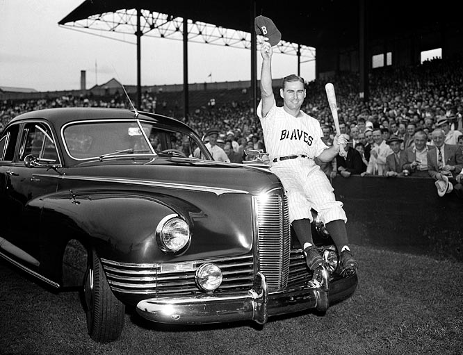 Holmes had a solid career with the Boston Braves from 1941-1952, hitting over .300 every year from 1944 through 1948. His best season came in 1945, though, when he led the NL in hits (224), home runs (28) and doubles (47), finished second in batting (.352) and had a 37-game hitting streak.