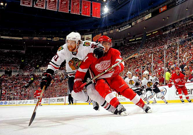 Blackhawks defenseman Brian Campbell tries to muscle his way around Detroit center Valtteri Filppula during Game 5. Campbell, Chicago's highest paid player, posted just one assist and a minus-5 in the series against Detroit, while Filppula scored at least a point-a-game in the five game series.