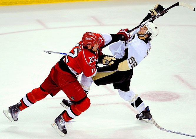 Eric Staal lunges at Penguins' defenseman Kris Letang during Game 4 of the Eastern Conference Finals. Staal scored (1:36 into the game) for the first time in the series for the Hurricanes, who lost for the first time in these playoffs when their franchise player notched a goal.