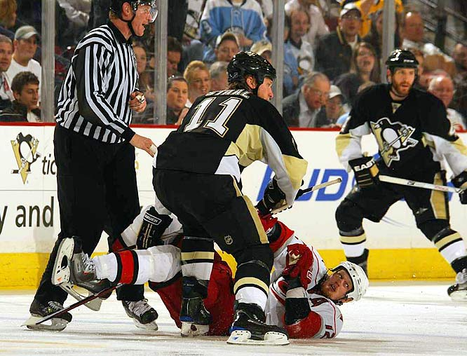 Jordan Staal knocks his big brother Eric to the ice during Game 1 of the Eastern Conference Finals in Pittsburgh on May 18.  The last time siblings skated against each other in the Conference finals was in 1974 - when Phil Esposito's Bruins faced Tony's Blackhawks.