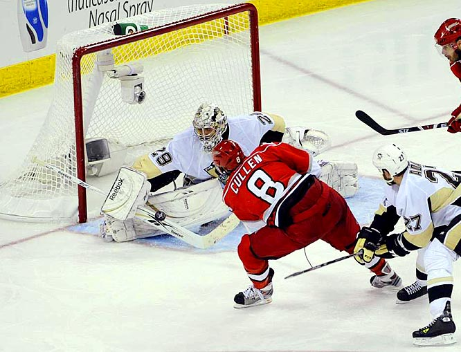 Marc-Andre Fleury stops a shot by the Hurricanes' Matt Cullen in the third period of Game 5.  Fleury stopped the final 30 shots he faced in shutting down Carolina during the last 58 minutes.