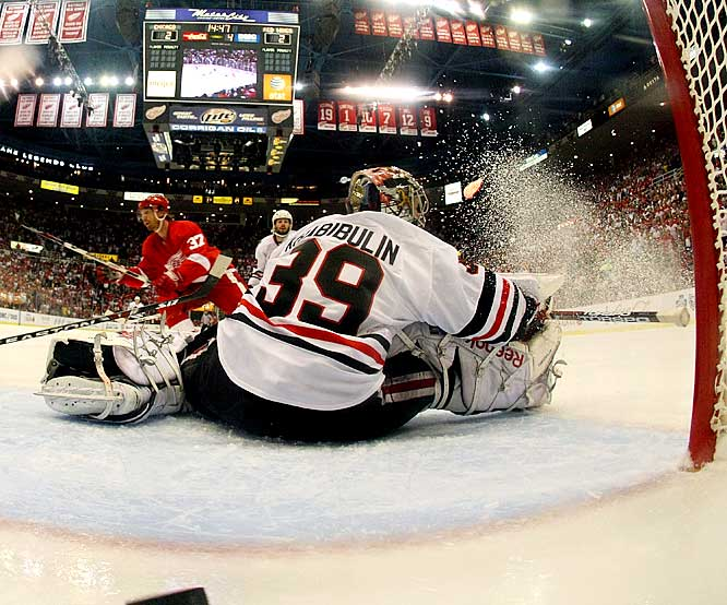 Mikael Samuelsson scores the game-winning goal in overtime against Blackhawks goalie Nikolai Khabibulin in Game 2 of the Western Conference Finals.  The OT win put the Red Wings up 2-0 in the best-of-seven series.
