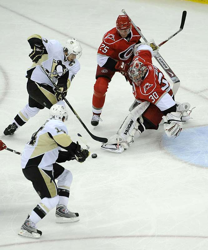 Pittsburgh's Sidney Crosby (left) puts the pressure on Carolina's Cam Ward during Game 3 of their Eastern Conference finals May 23. Crosby picked up a goal and an assist as the Pens took a 3-0 series lead after their 6-2 win.