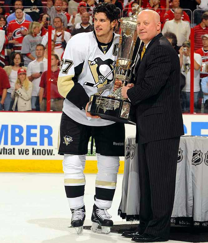 Sidney Crosby saved his most daring move for after the Pens' series win: He spurned hockey superstition and hoisted the Prince of Wales Trophy, presented to the Eastern Conference Champions, here by NHL Deputy Commissioner Bill Daly.  The Penguins are headed back to the Stanley Cup finals, clinching a return trip with a 4-1 rout of the Carolina Hurricanes on Tuesday, May 26, that finished off a sweep in the Eastern Conference finals. Pittsburgh lost to Detroit last year in a six-game final series.
