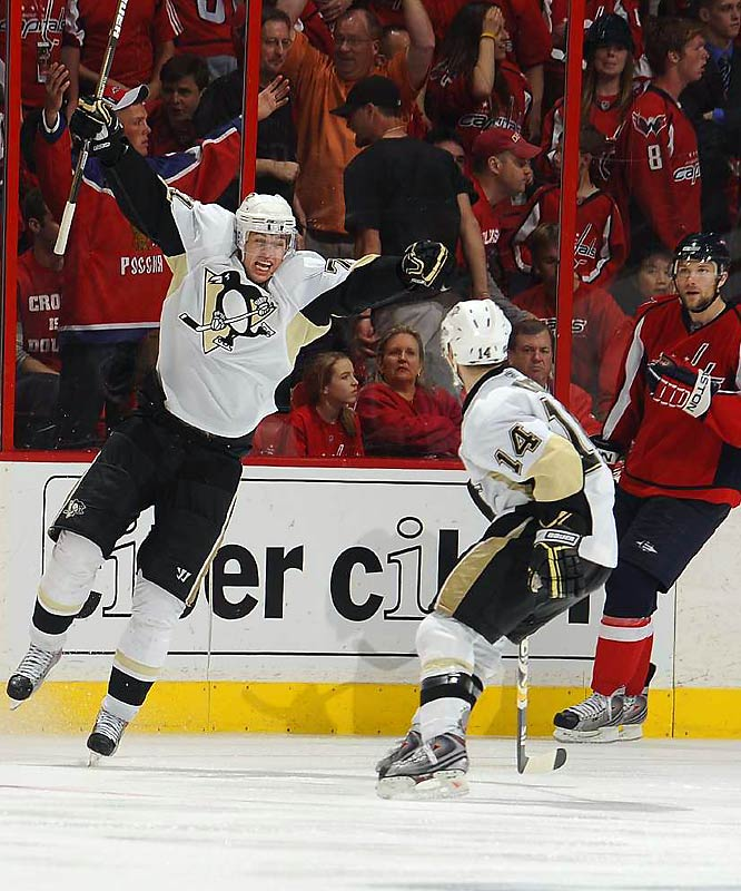 Penguins center Evgeni Malkin celebrates after his pass to Sidney Crosby deflected off Capitals defenseman Tom Poti and into the goal to seal a Game 5 overtime victory for Pittsburgh.