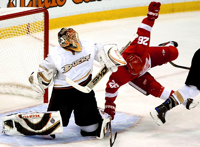 The Red Wings' Jiri Hudler falls in front of Ducks goalie Jonas Hiller in the third period of Game 1.  Detroit won the game 3-2.