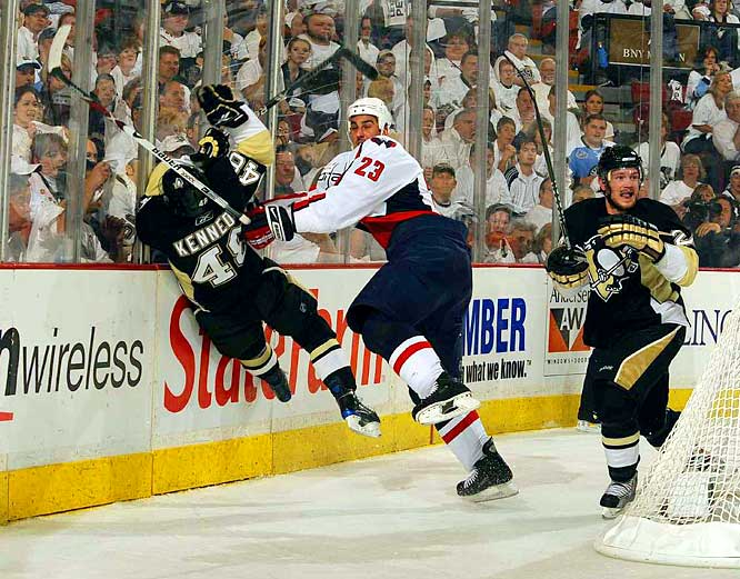 Capitals defenseman Milan Jurcina checks Tyler Kennedy along the boards during Game 3.  The Penguins won 3-2.