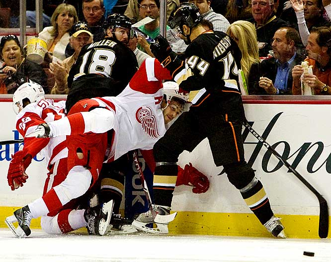(Left to right) Brad Stuart, Drew Miller, Pavel Datsyuk, and Rob Niedermayer battle for the puck in the first period of Game 3.  The Ducks defeated the Red Wings 2-1.