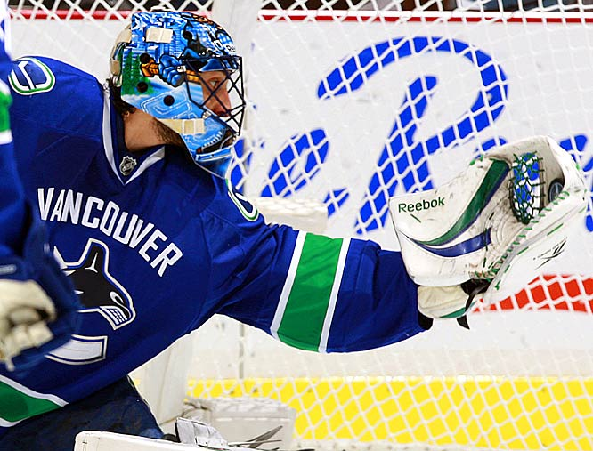 The Canucks' Roberto Luongo makes a glove save against the Blackhawks.