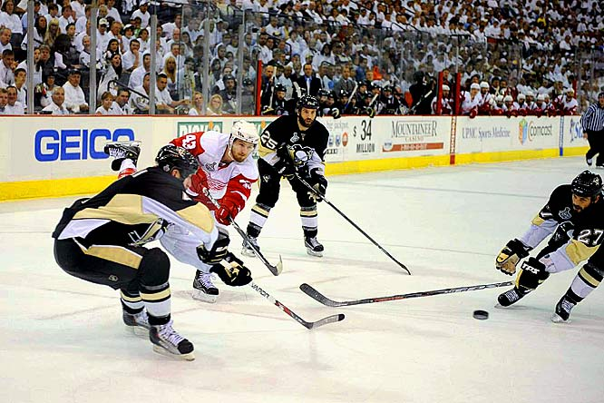 Rob Scuderi's (left) clearing attempt deep in Pittsburgh's defensive zone was intercepted by Detroit's Darren Helm, who capitalized on the opportunity by scoring an unassisted goal. Helm's goal tied the game at 1-1 late in the first period.
